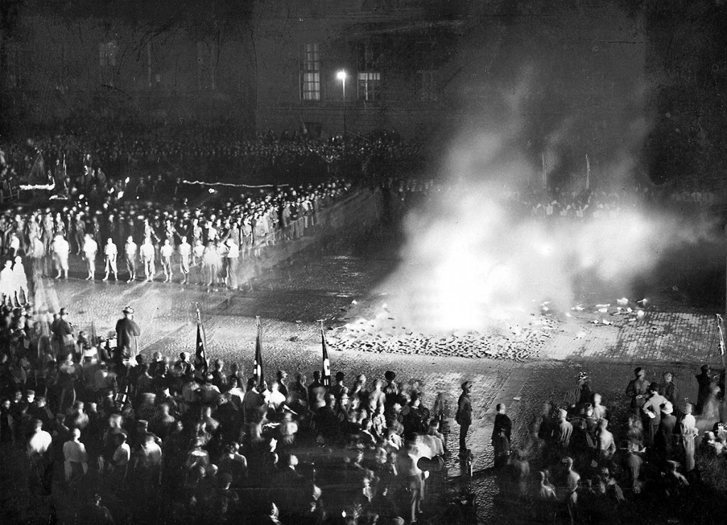 "In 1933, in towns across Germany, thousands of books were set aflame because they were considered ""un-German.""  This was the beginning of the war of ideas.  For the next twelve years, the Nazis banned, bombed, and burned books and libraries across Europe to restrict the flow of ideas. Photo Credit: Mary Evans Picture Library/Süddeutsche Zeitung Photo."