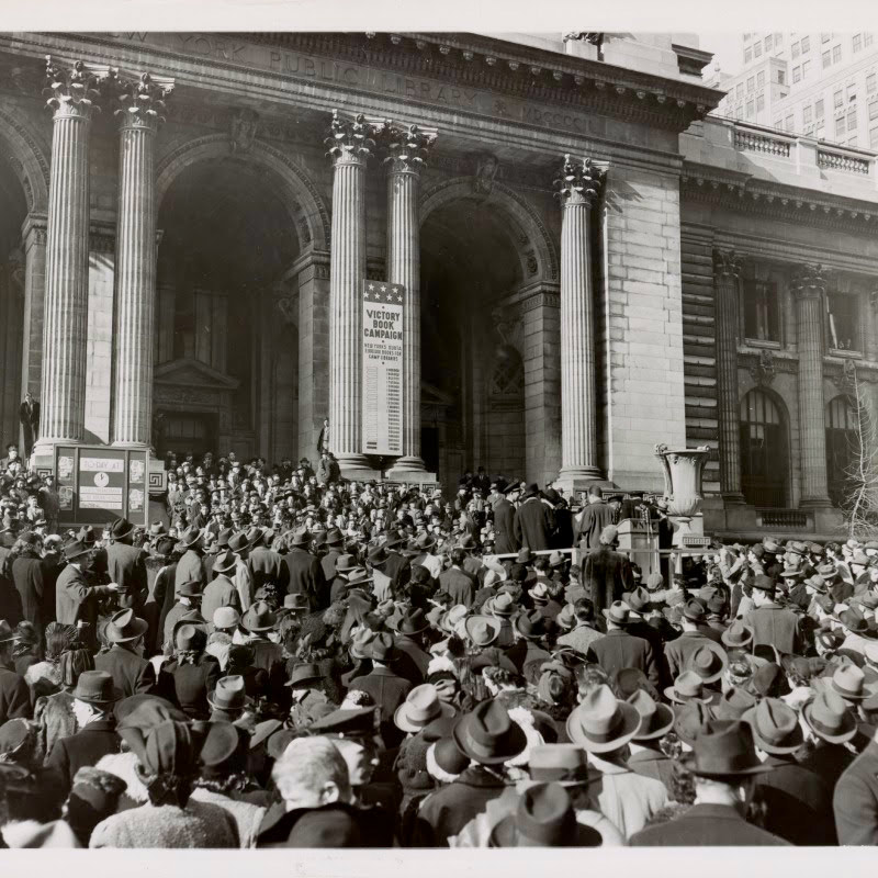 During the 1942 Victory Book Campaign, librarians set a goal of collecting ten million books for American troops.   Special events were held to promote the book campaign and secure donations.  Here, thousands of people gather on the steps of the New York Public Library to donate books. Photo Credit: Manuscripts and Archives Division, New York Public Library, Astor, Lenox and Tilden Foundations